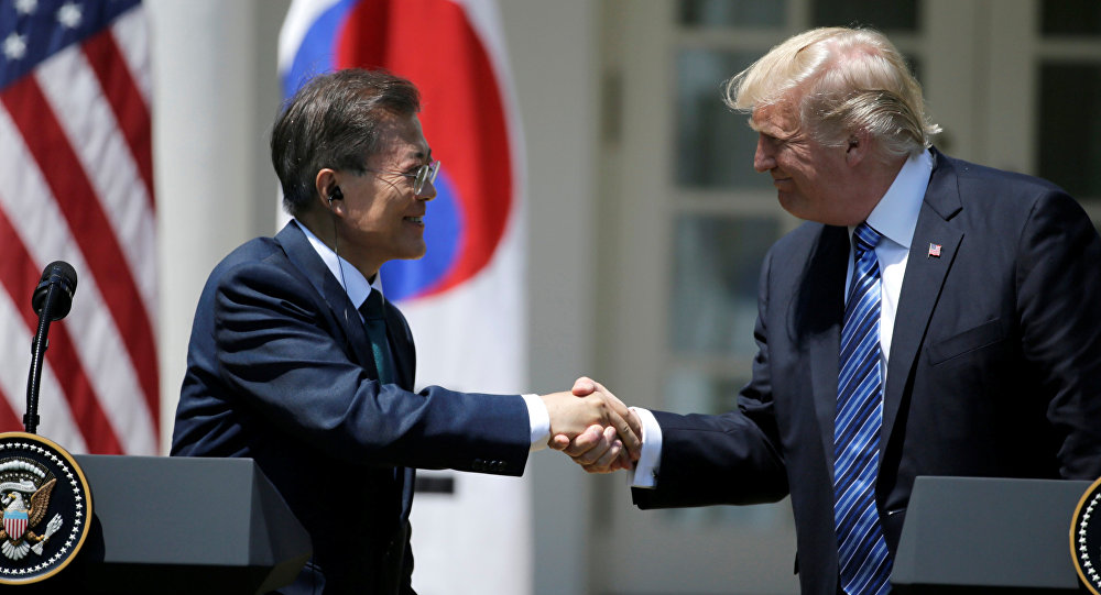 U.S. President Donald Trump (R) greets South Korean President Moon Jae-in