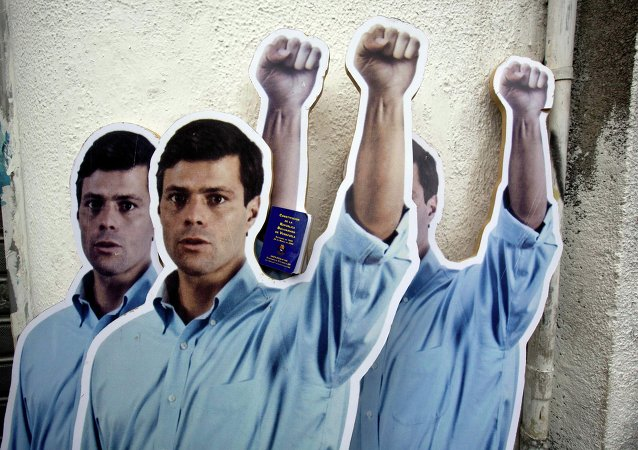 Supporters placed life-size cardboard cutouts of opposition leader Leopoldo Lopez outside the Justice Palace as the trial against Lopez for inciting violence at anti-government protests began, in Caracas, Venezuela, Wednesday, July 23, 2014