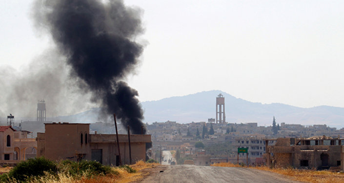 Smoke rises from Taybat al Imam town after rebel fighters from the hardline jihadist Jund al-Aqsa advanced in the town in Hama province, Syria August 31, 2016.
