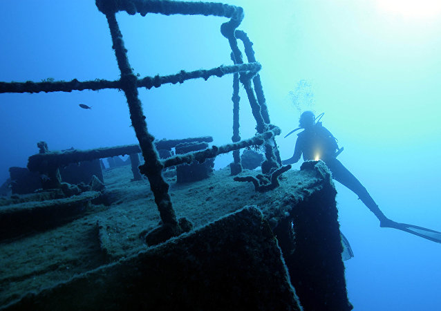 A Turkish diver passes by the wreckage of a ship located off the city of Kas in the Mediterranean sea, 11 June 2004. This area is a world-known site for divers and archaeologists, interested in the scores of ship wreckages lying on the seabed