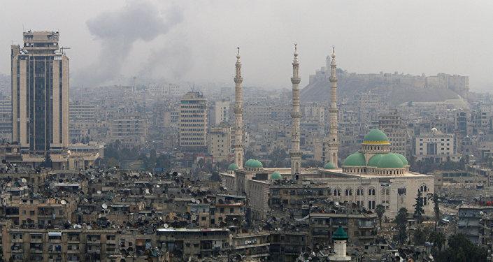 Smoke rises after strikes on Aleppo, Syria