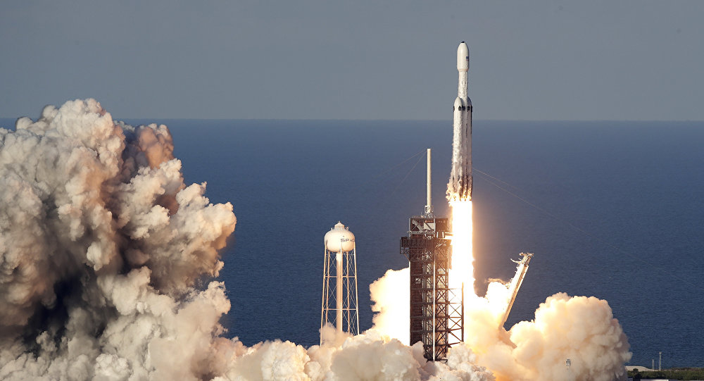 A SpaceX Falcon Heavy rocket carrying a communication satellite lifts off from pad 39A at the Kennedy Space Center in Cape Canaveral, Fla., Thursday, April 11, 2019