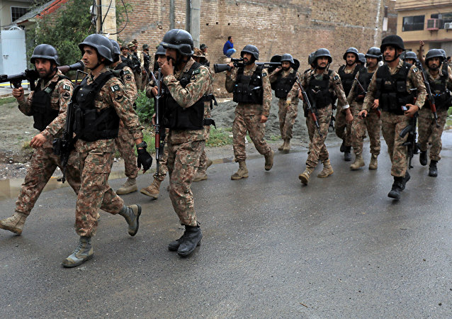 Soldiers arrive at a street after a shootout in Hayatabad area, Peshawar, Pakistan, April 16, 2019