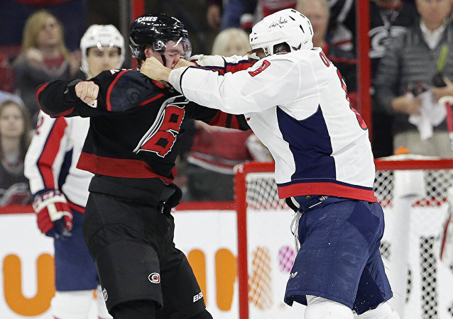Washington Capitals' Alex Ovechkin, right, of Russia, punches Carolina Hurricanes' Andrei Svechnikov, also of Russia, during the first period of Game 3 of an NHL hockey first-round playoff series in Raleigh, N.C., Monday, April 15, 2019.