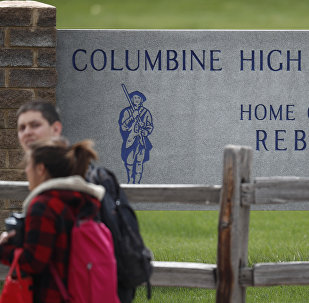 Students leave Columbine High School late Tuesday, April 16, 2019, in Littleton, Colo. Following a lockdown at Columbine High School and other Denver area schools, authorities say they are looking for a woman suspected of making threats.