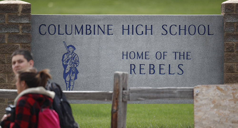 Littleton Colo. Following a lockdown at Columbine High School and other Denver area schools authorities say they are looking for a woman suspected of making threats