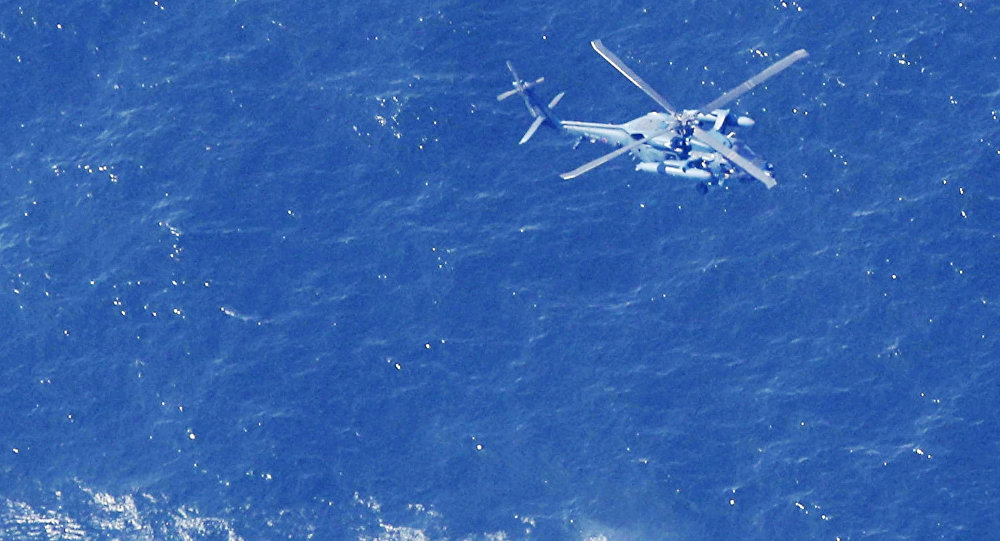 A Japan Air Self-Defense Force helicopter conducts rescue and search operation at the site where an Air Self-Defense Force's F-35A stealth fighter jet crashed during an exercise on April 9, 2019, off Aomori prefecture, Japan, in this photo taken by Kyodo April 10 2019