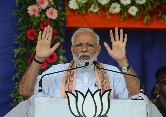 Indian Prime Minister Narendra Modi (C) addresses a political rally at Himmatnagar, some 70 km from Ahmedabad on April 17, 2019