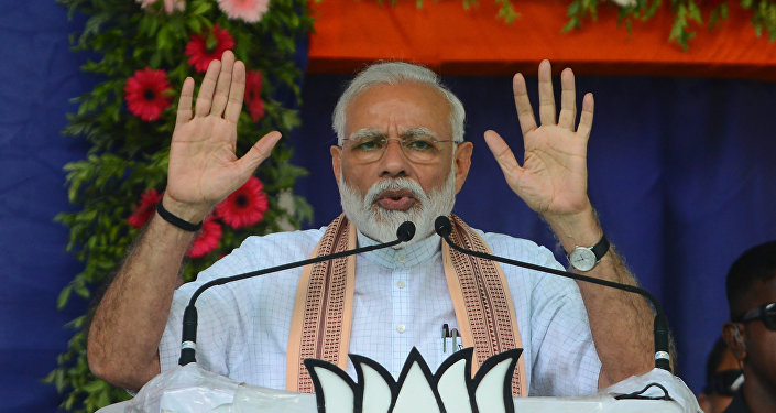Indian Prime Minister Narendra Modi (C) addresses a political rally at Himmatnagar, some 70 km from Ahmedabad on 17 April, 2019
