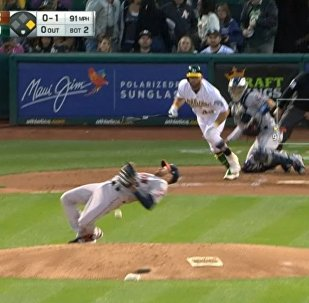 Houston Astros pitcher Collin McHugh pulling off a Matrix-like move to dodge a line drive in the second inning of Tuesday's 9-1 away victory for the Astros in Oakland