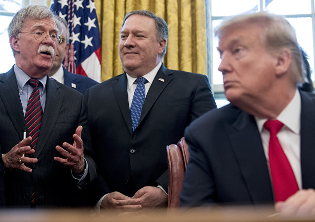 From left, National Security Adviser John Bolton, accompanied by Secretary of State Mike Pompeo, and President Donald Trump