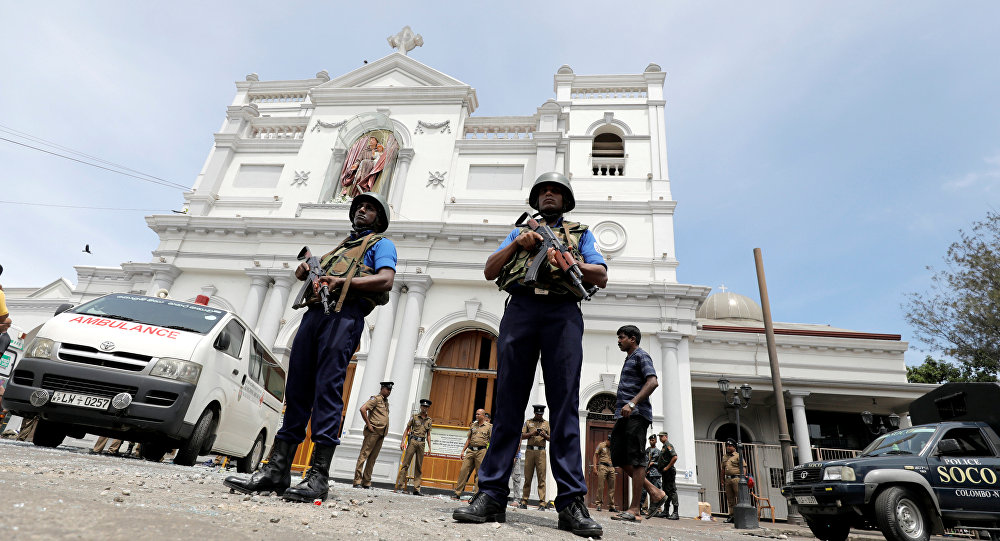 Sri Lankan military officials stand guard in front of the St. Anthony's Shrine in Colombo after explosion.