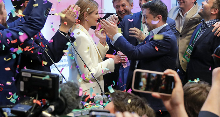 Ukrainian comedian and presidential candidate Volodymyr Zelenskiy, center right, and his wife Olena Zelenska, center left, greet their supporters at his headquarters
