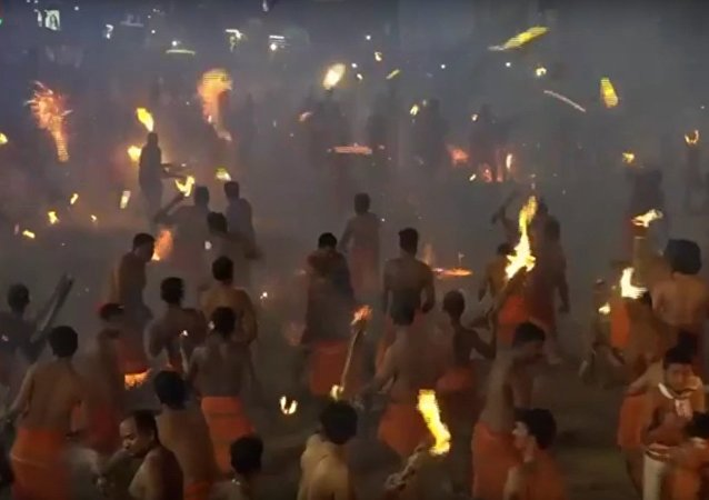 Visuals of the 'Agni Kheli' or Thoothedhara ritual from Sri Durgaparamesh
