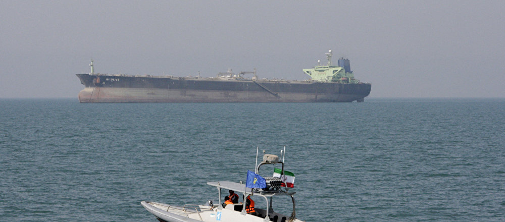 Iranian Revolutionary Guard speedboat moves in the Persian Gulf near an oil tanker (File)