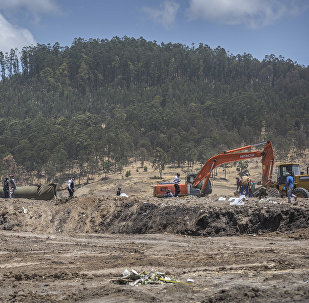 Recovery work continues at the scene where the Ethiopian Airlines Boeing 737 Max 8 crashed shortly after takeoff