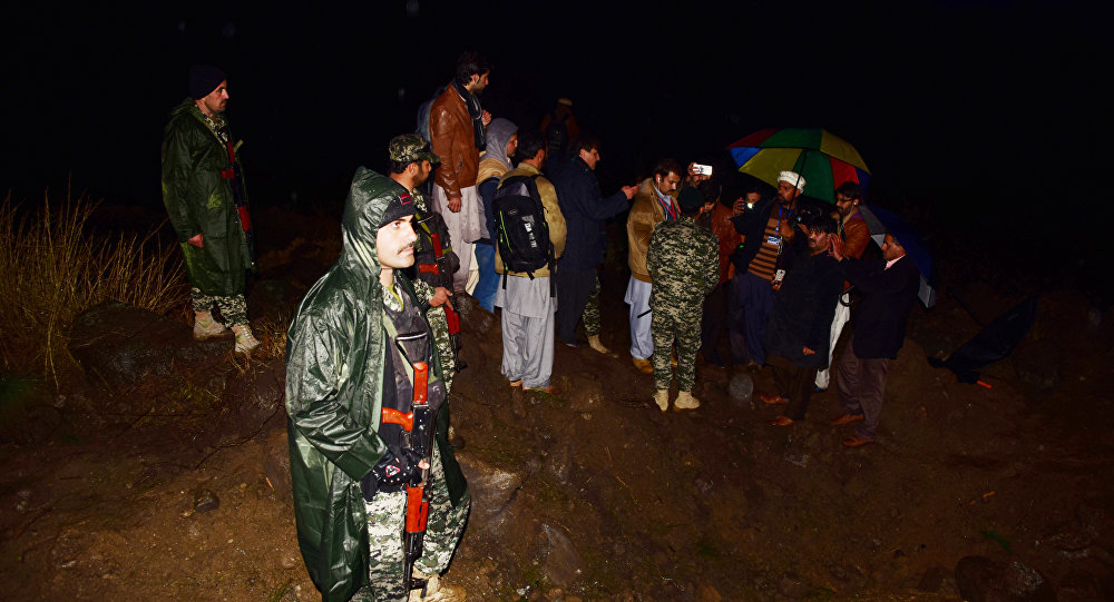 Pakistani soldiers and media personnel gather at the site where the Indian Air Force (IAF) strike launched on a Jaish-e-Mohammad (JeM) camp at Balakot on February 26, 2019. India said on February 26, 2019, it had launched air strikes against militant camps in Pakistan's territory, triggering international concern over a dangerous escalation between the nuclear-armed rivals