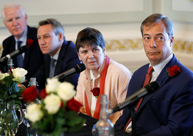 Brexit campaigner and Member of the European Parliament Nigel Farage, Claire Fox, James Glancy and Matthew Patten, candidates of Brexit party, look on during a news conference by the 'Brexit Party' campaign for the European elections, in London, Britain April 23, 2019
