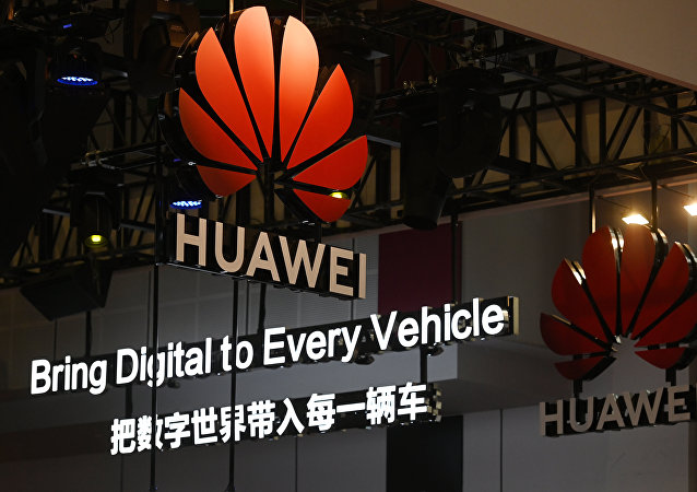 Signs are displayed at the Huawei stand at the Shanghai Auto Show in Shanghai on 17 April, 2019