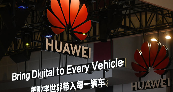 Signs are displayed at the Huawei stand at the Shanghai Auto Show in Shanghai on April 17, 2019