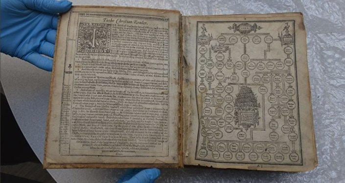 FBI agents in Pittsburgh on April 25 display the stolen 1615 Geneva bible found in a Leiden museum and returned to the Carnegie Library of Pittsburgh.