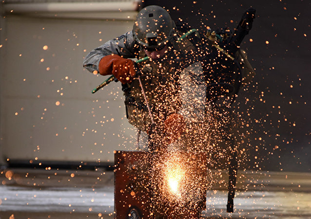 Staff Sgt. Patrick Hadfield, 341st Security Forces Group Tactical Response Force member, demonstrates thermal breaching using a broco torch Nov. 18 at Malmstrom Air Force, Mont. The torch is an extremely powerful tool that has the capability of cutting thick steel, aluminum, cast iron and more.