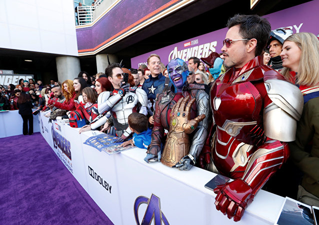 Fans dressed up in costume await the cast members on the red carpet at the world premiere of the film The Avengers: Endgame in Los Angeles