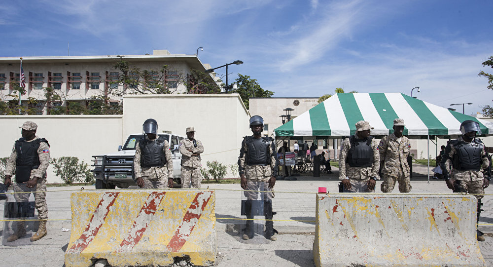 Police stand guard as Haitians gather in front of the US Embassy in Port-au-Prince during a sit-in to express their dissatisfaction with the recent remarks that have been made about Haiti by US President Donald Trump.