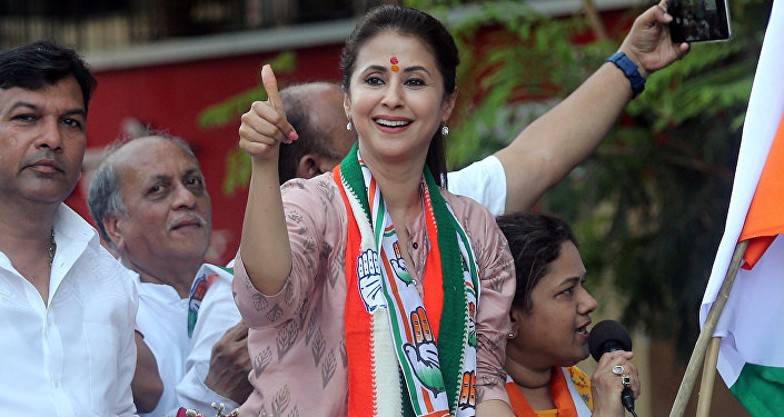Urmila Matondkar, Bollywood actress-turned-politician who recently joined India's main opposition Congress party, gestures during her election campaign rally in Mumbai, India, April 11, 2019