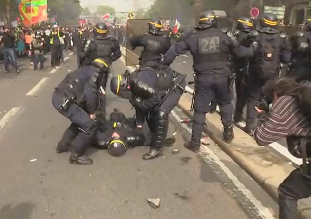 Cop Collapses During 1 May Rally