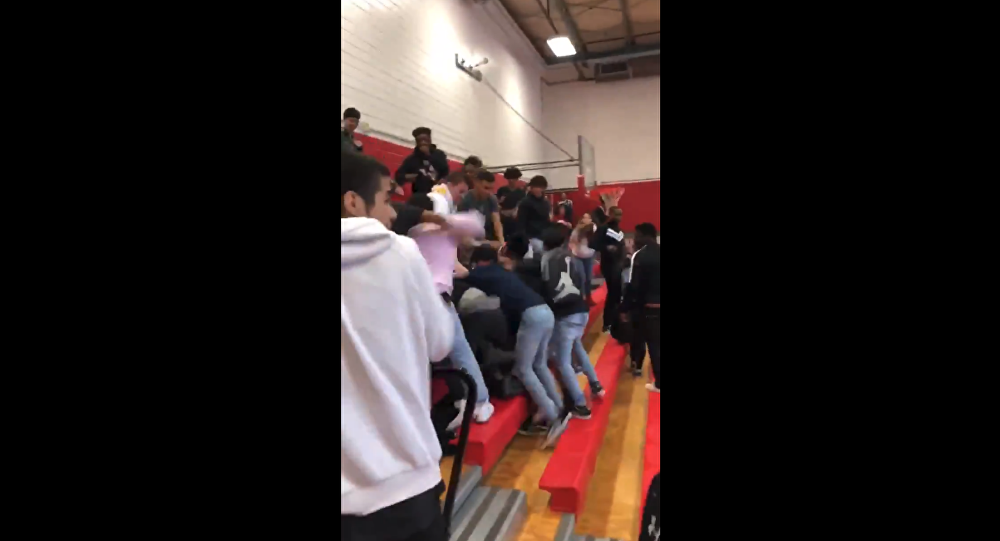 Massive brawl at Waltrip High School in Houston, Texas, unfolds in school gymnasium, leaving multiple students injured.