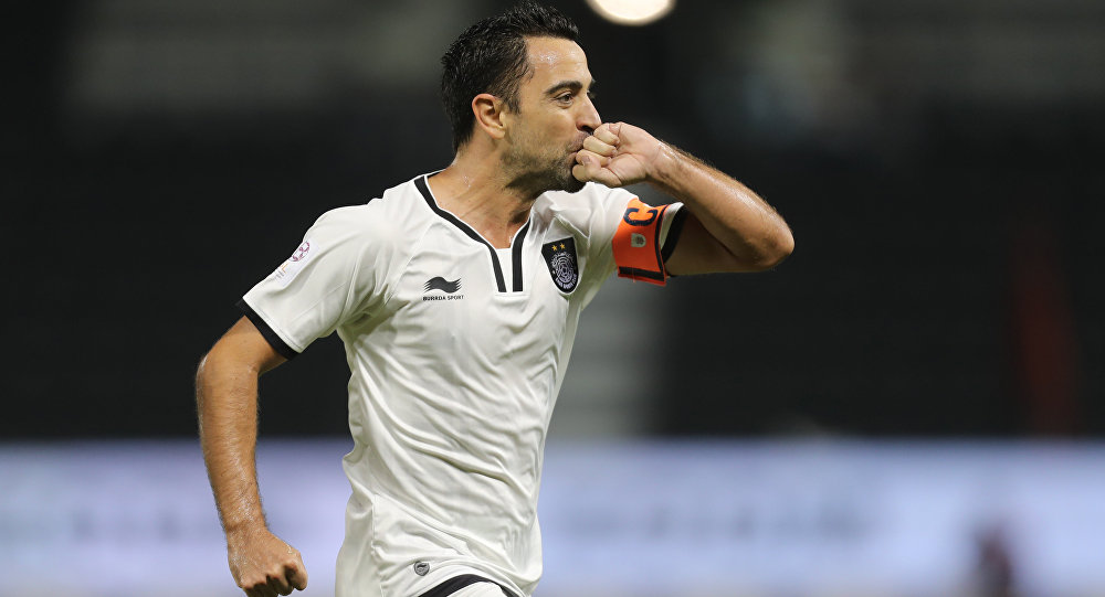 Qatari Al-Sadd club's Xavi Hernandez celebrates scoring a goal against Al-Rayyan's team during their Qatar Stars League football match at the Jassim Bin Hamad stadium in Doha on December 7, 2016
