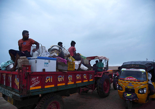Villagers sit on a vehicle as they leave for a safer place ahead of cylcone Fani on the outskirts of Konark in the eastern state of Odisha, India, May 2, 2019.