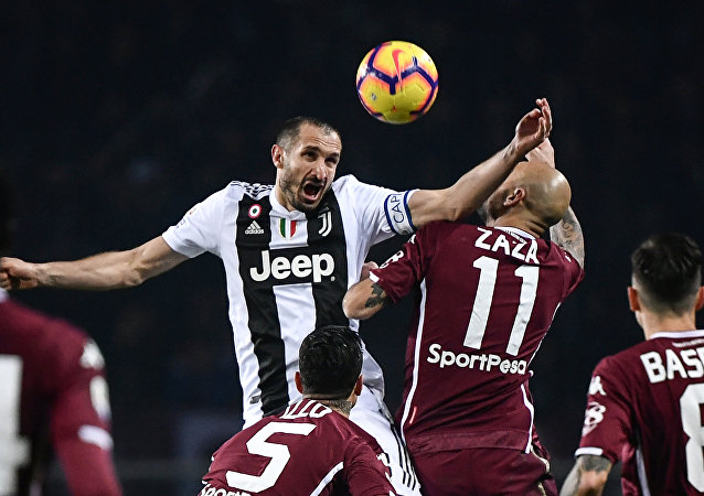Torino striker Simone Zaza challenges for the ball with Juventus defender Giorgio Chiellini during the Turn derby in December 2018