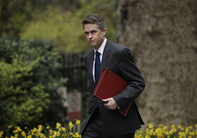 In this Tuesday, April 2, 2019 file photo, Britain's Defence Secretary Gavin Williamson arrives for a cabinet meeting in 10 Downing Street, London