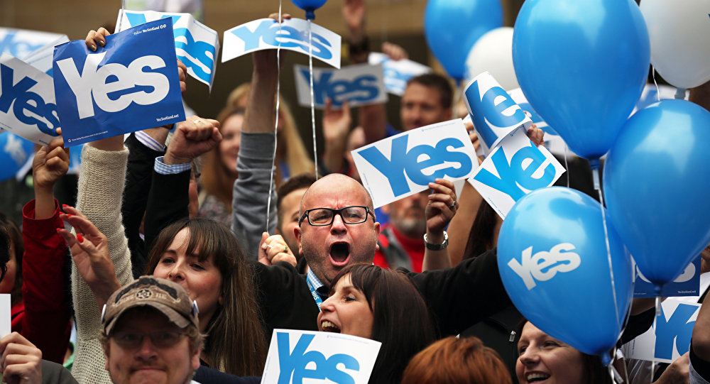 People react during a pro Scottish independence campaign rally, in central Glasgow, Scotland