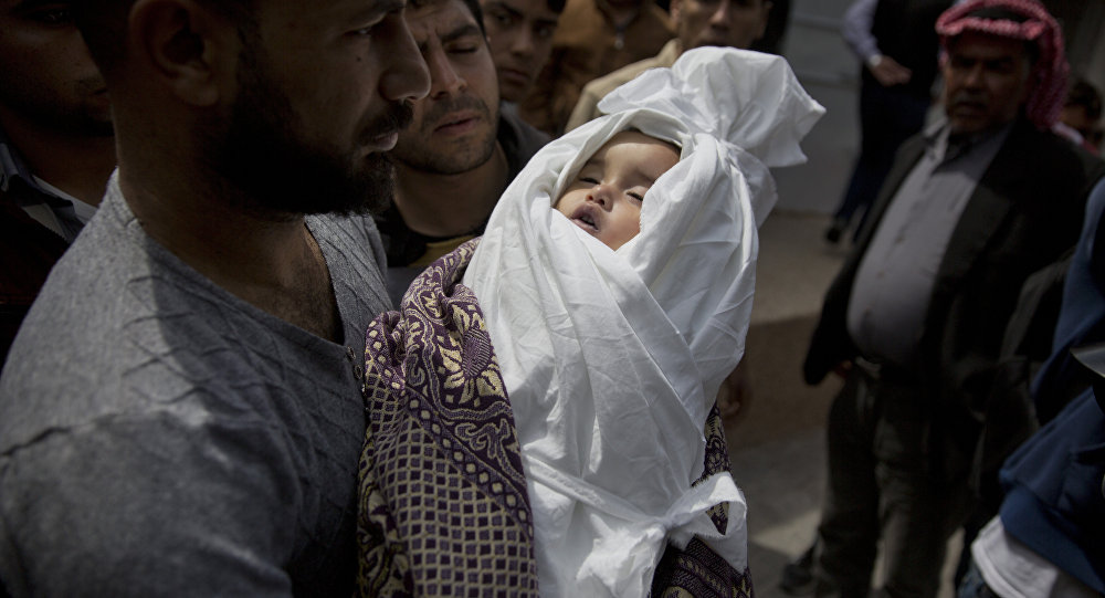 A relative of a Palestinian, 14-month-old, Seba Abu Arar, carry her body out of the Shifa hospital morgue before her funeral in Gaza City, Sunday, May. 5, 2019. Gaza's Health Ministry said the Palestinian infant was killed when Israeli aircraft hit near her house