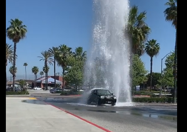 Waste Not, Want Not: Motorists Take Advantage of Broken Hydrant