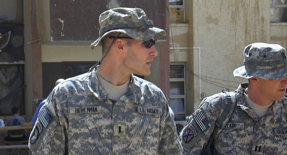 Sept. 21, 2008, file photo, 1st Lt. Michael C. Behenna, left, and his defense attorney Capt. Tom Clark, right, walk in Camp Speicher, a large U.S. base near Tikrit, north of Baghdad, Iraq
