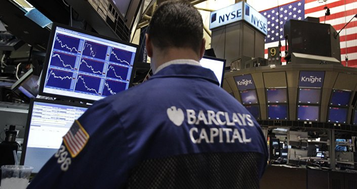 Stocks are shown plunging in graphs on monitors at Barclays Capital booth on the floor of the New York Stock Exchange in New York, Tuesday, Feb. 22, 2011