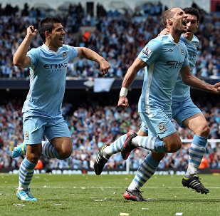 Pablo Zabaleta celebrates with Manchester City team-mates after scoring in the final game of the Premier League season in 2012