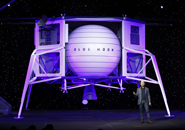 Jeff Bezos speaks in front of a model of Blue Origin's Blue Moon lunar lander, Thursday, 9 May, 2019, in Washington
