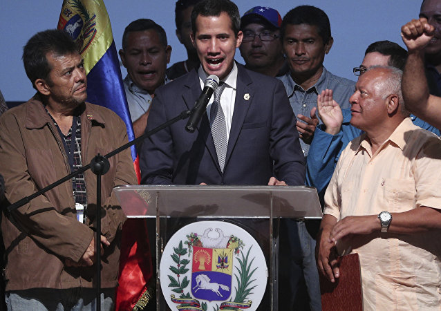 Venezuela's opposition leader and self proclaimed interim President Juan Guaido, center, speaks during a meeting with oil workers at the Metropolitan University of Caracas, Venezuela, Friday, May 3, 2019