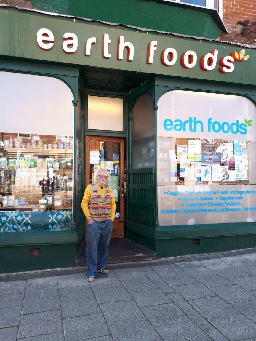 Carl Hardman, pictured outside his health food shop in Bournemouth, England, says Big Pharma is involved in a conspiracy
