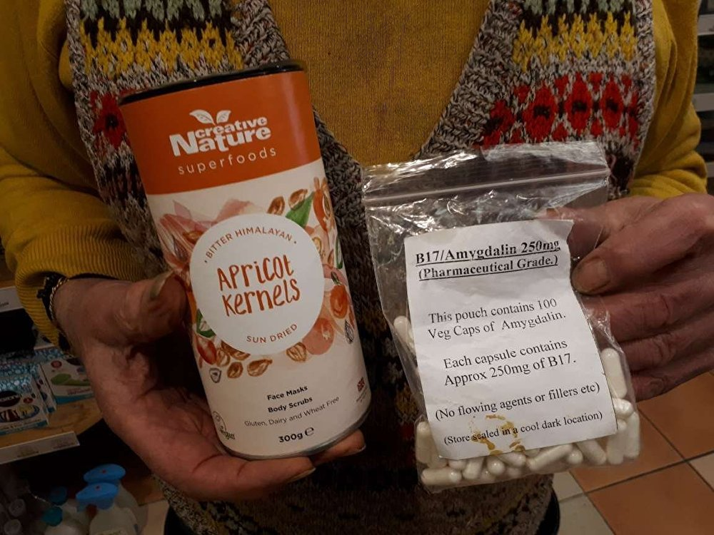 Amygdalin or B17 (the packet on the right) is made from apricot kernels (left) but is illegal to sell in the UK