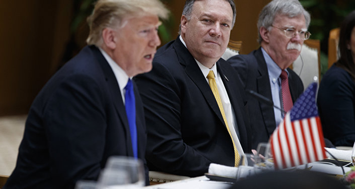 Secretary of State Mike Pompeo, center, and national security adviser John Bolton, right, listen as President Donald Trump speaks during a meeting with Vietnamese Prime Minister Nguyen Xuan Phuc at the Office of Government Hall, Wednesday, Feb. 27, 2019, in Hanoi