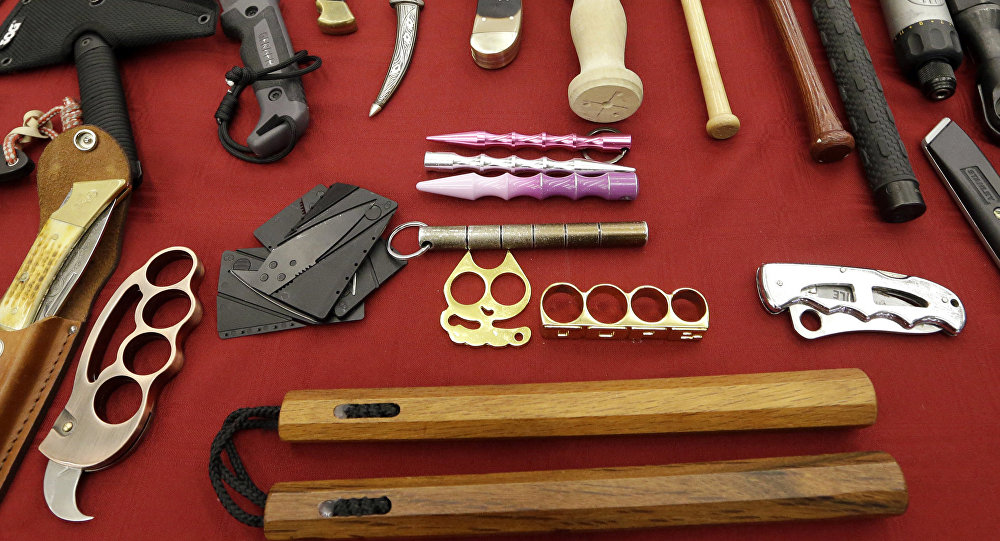 In this 6 April 2017, file photo, objects confiscated from passengers' carry-on luggage, including nunchucks, bottom, are displayed at Seattle-Tacoma International Airport in SeaTac, Wash.