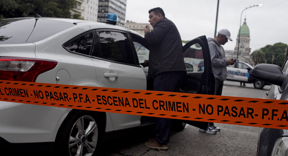 Police stand near the crime scene where Argentine lawmaker Hector Olivares was seriously injured