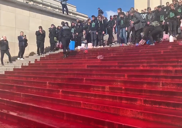 Extinction Rebellion activists protest in Paris, using fake blood