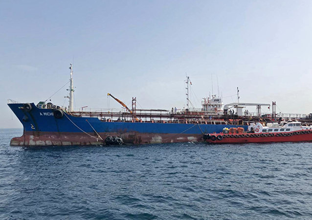 A picture taken on May 13, 2019 off the coast of the Gulf emirate of Fujairah shows the A. Michel tanker under the flag of the United Arab Emirates, one of the four tankers damaged in alleged sabotage attacks in the Gulf the previous day.